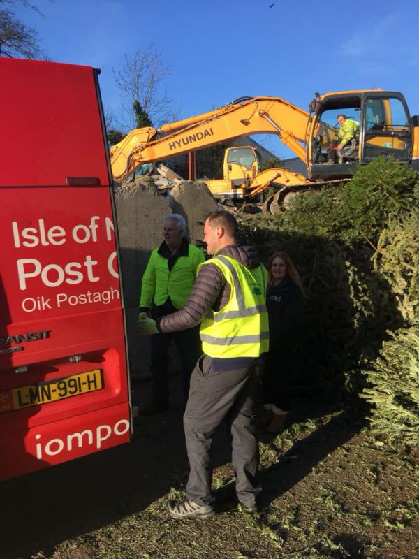 Volunteers from IOM Post Office hard at work