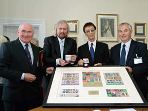 Alex, Barry, Robin and Alan Gibb with Isle of Man Stamps