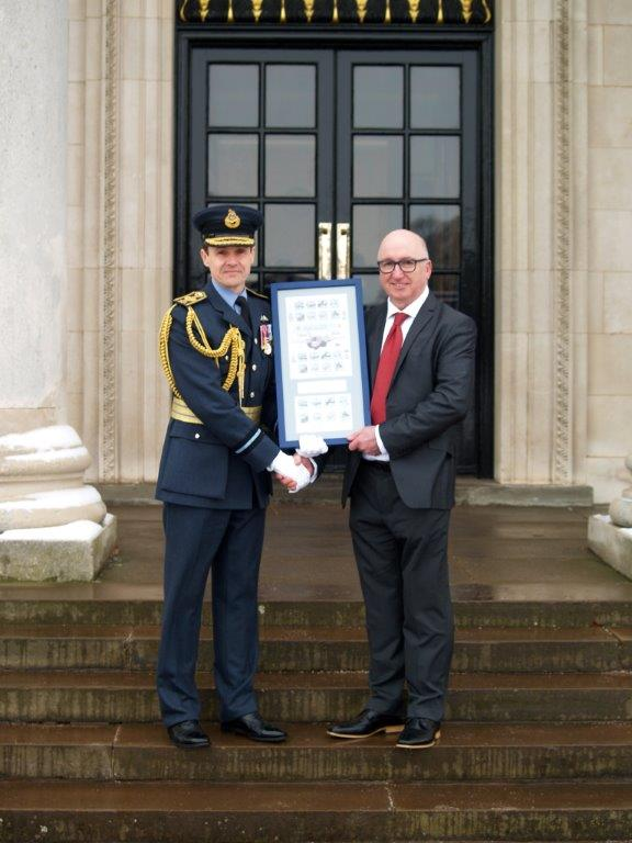 Tony Randle, representative from the Isle of Man Post Office, presenting the 100 Years of the RAF Commemorative Plaque to the Royal Air Force College Cranwell