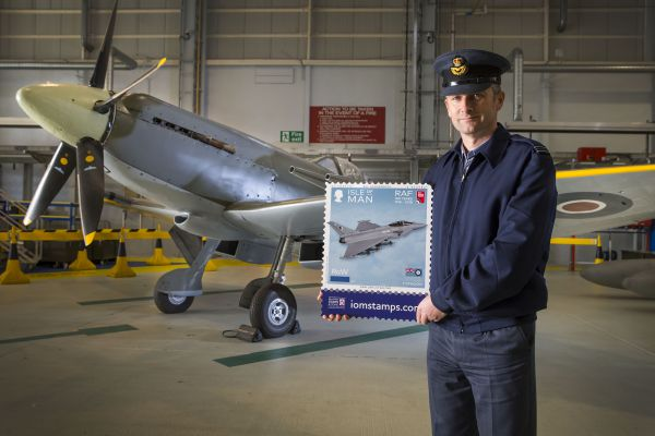 Flight Lieutenant Danny Streames from RAF Lossiemouth, with a Spitfire in the background