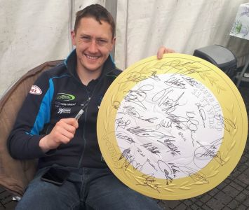 A Chance to Own Two Steve Hislop Memorial Coin Boards Signed by Motorbike Racing Royalty