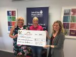 Isle of Man Post Office staff help raise £214 to support Rebecca House