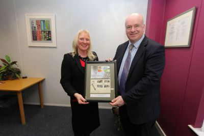 Chief Minister Howard Quayle MHK presented with framed set of stamps by Isle of Man Post Office Chairman Julie Edge MHK at recent visit