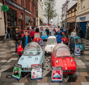 Isle of Man Post Office marks 50 years of Peel Cars with special postmark cover unveiled at 'Peels to Peel' Festival launch